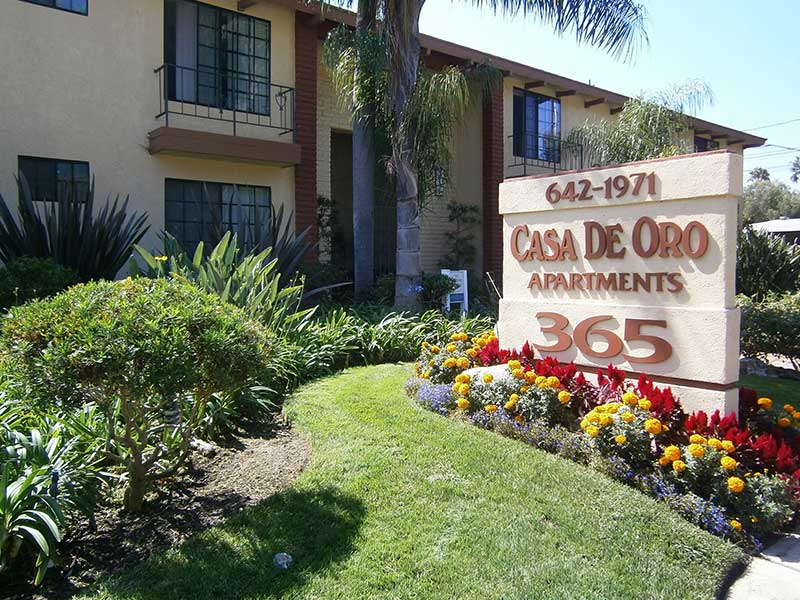 Casa De Oro Apartment complex sign